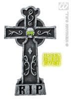 Grafsteen kruis met doodshoofd met groen verlichten ogen